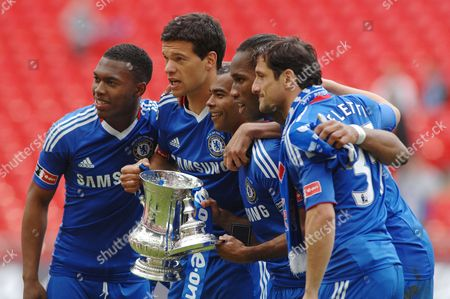 Football - Chelsea v Portsmouth FA Cup Final 15/05/2010 at Wembley Chelsea players with the trophy L to R Daniel Sturridge Michael Ballack Asley Cole Didier Drogba and Juliano Belletti