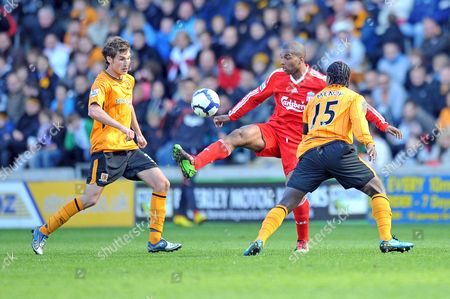 Football - Premier League - Hull City vs Liverpool Ryan Babel (Liverpool) juggles the ball as Bernard Mendy and Will Atkinson (Hull) can only watch at the KC Stadium