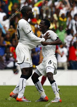 Football - International Friendly - Ghana vs Lativa Quincy Owusu-Abeyie of Ghana celebrates with Anthony Annan of Ghana at Stadium mk