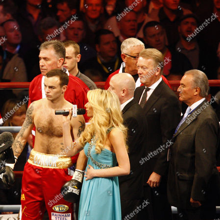 Boxing - Interim WBO World Lightweight Title - Kevin Mitchell vs Michael Katsidis Kevin Mitchell ( Red Shorts ) whilst Stacy Solomon sings the National anthem in the background Frank Warren and Trainer Jimmy Tibs at Boleyn Ground Upton Park