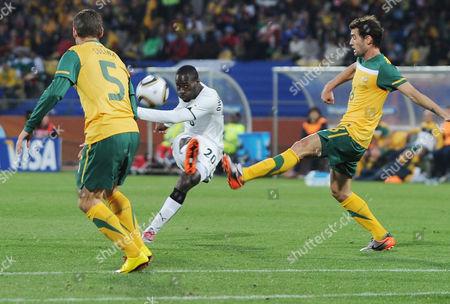 Football - World Cup Finals 2010 Australia v Ghana Carl Valeri (Aus) Quincy Owusu Abeyie (Ghana) 19/06/2010 at Rustenburg