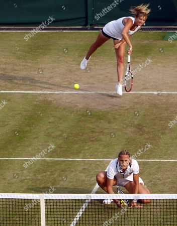 Tennis - The Wimbledon Championships - Serena Williams and Venus Williams ( USA ) vs Timea Baxsinszky ( SUI ) and Tathiana Garbin ( ITA ) Timea Baxsinszky ( SUI ) and Tathiana Garbin ( ITA ) at the All England Lawn Tennis and Croquet Club