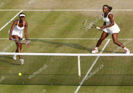 Tennis - The Wimbledon Championships - Serena Williams and Venus Williams ( USA ) vs Timea Baxsinszky ( SUI ) and Tathiana Garbin ( ITA ) Serena Williams and Venus Williams ( USA ) at the All England Lawn Tennis and Croquet Club