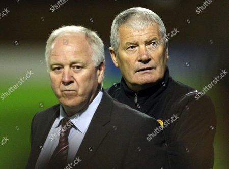 Stock Image of Football - Europa League - Motherwell vs Odense BK A dejected Motherwell management team of Craig Brown and Archie Knox during Motherwell vs Odense BK third round second leg Europa League match at Fir Park United Kingdom Glasgow