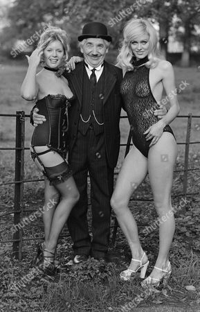 Mary Millington with Alfie Bass and  model on the set of 'Come Play with Me'