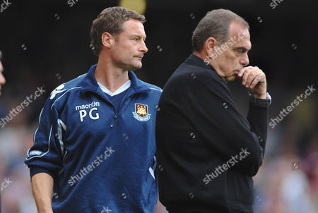 Stock Picture of Football - A dejectjed Avram Grant (West ham manager) and assistant Paul Groves West Ham United v Chelsea 11/09/2010