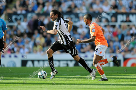 Football - Barclays Premier League - Newcastle United vs Blackpool Jonas Gutierrez (Newcastle United) and Elliot Grandin (Blackpool) at St James' Park