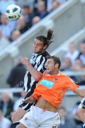 Football - Barclays Premier League - Newcastle United vs Blackpool Andrew Carroll (Newcastle United) battlers for the ball with Dekel Keinan (Blackpool) at St James' Park