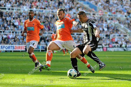 Football - Barclays Premier League - Newcastle United vs Blackpool Jose Enrique (Newcastle United) and Neil Eardley (Blackpool) battle for the ball also seen Elliot Grandin (Blackpool) at St James' Park