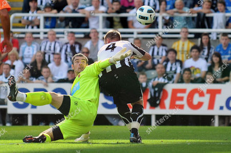 Football - Barclays Premier League - Newcastle United vs Blackpool Keith Southern (Blackpool) still tries to stop the ball after colliding with Kevin Nolan (Newcastle United) at St James' Park