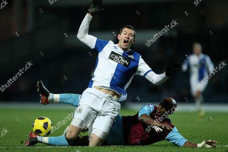 Football - Premier League - Blackburn vs West Ham Brett Emerton of Blackburn Rovers tackled by Luis boa Morte of West Ham at Ewood Park