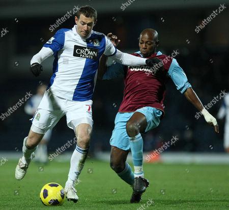 Football - Premier League - Blackburn vs West Ham Brett Emerton of Blackburn Rovers under pressure from West Ham's Luis Boa Morte at Ewood Park