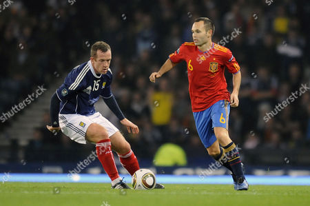 Football - Euro 2012 Qualifying - Scotland vs Spain Andres Iniesta (Spain) and Charlie Adam (Scotland) at Hampden Park