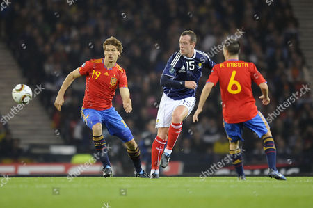 Football - Euro 2012 Qualifying - Scotland vs Spain Charlie Adam (Scotland) also Fernando Llorente (Spain) at Hampden Park