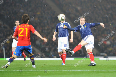 Football - Euro 2012 Qualifying - Scotland vs Spain Charlie Adam (Scotland) strikes the ball goalwards at Hampden Park