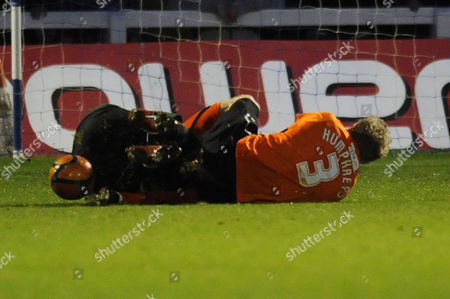 Football - FA Cup First Round - Hartlepool United vs Vauxhall Motors both Scott Tynan (Vauxhall Motors) and Ritchie Humphreys (Hartlepool United) lie on the pitch at Victoria Park