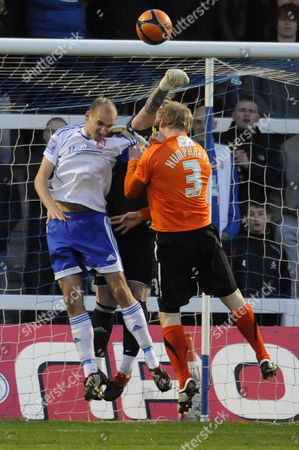 Football - FA Cup First Round - Hartlepool United vs Vauxhall Motors Scott Tynan (Vauxhall Motors) punches clear with Ritchie Humphreys (Hartlepool United) closing in at Victoria Park