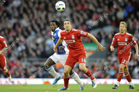Football - Premier League - Liverpool vs Blackburn Rovers Sotirios Kyrgiakos (Liverpool) and Benjani Mwaruwari (Blackburn Rovers) at Anfield