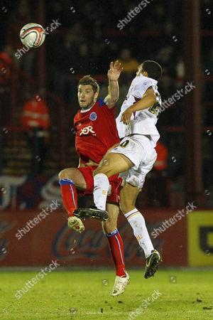 Football - League Two - Aldershot vs Bradford City Bradford's Tom Adeyemi and Aldershot's Ben Harding jump for the ball at The EBB Stadium