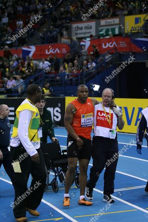 Athletics - AVIVA Grand Prix - Birmingham Mark Lewis-Francis hurts his foot in the 1st heat of the day in the men's 60m and has to be carried off my officials