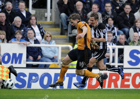 Football - Premier League - Newcastle United vs Wolverhampton Wanderers Peter Lovenkrands (Newcastle United) and Christophe Berra (Wolves) battle for the ball at St James' Park