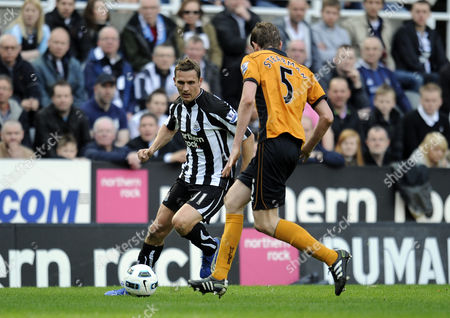 Football - Premier League - Newcastle United vs Wolverhampton Wanderers Peter Lovenkrands (Newcastle United) goes up against Richard Stearman (Wolves) at St James' Park
