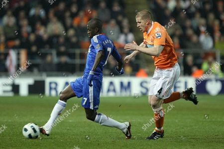 Football - Premier League - Blackpool vs Chelsea Blackpool's Keith Southern chases down Ramires of Chelsea at Bloomfield Road