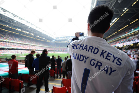 Football - Euro 2012 Qualifier - Wales vs England An England fan wears an team shirt with the names of the sacked Sky Sports presenters Richard Keys and Andy Gray at the Millennium Stadium Cardiff