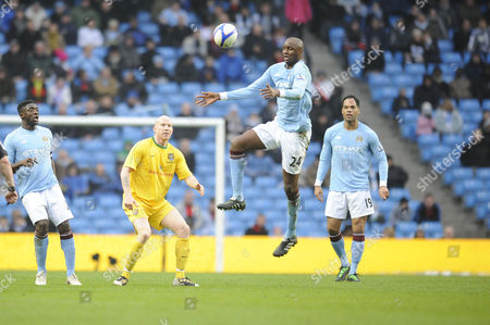 Football - FA Cup Fourth Round Replay - Manchester City vs Notts County Patrick Vieira (Manchester City) controls watching is Lee Hughes (Notts County) at The City of Manchester Stadium