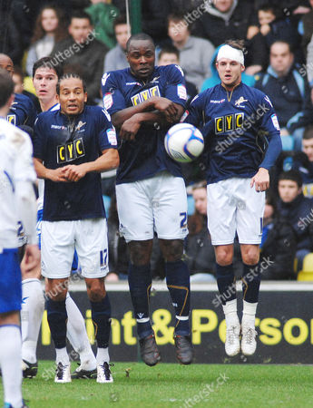 Football - Millwall v Birmingham City FA Cup 3rd rd 08/01/2011 David Murphy (Birmingham) chips the ball over the Millwall wall for their 3rd goal L to R Tamika Mkandawire Danny Shittu and Scott Barron
