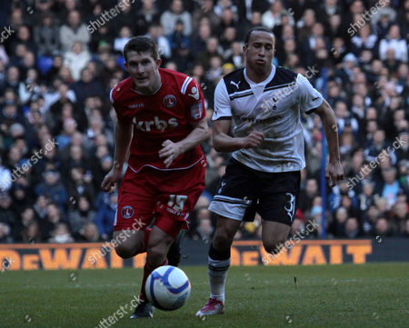 Stock Image of Football - FA Cup Third Round - Tottenham Hotspur vs Charlton Athletic Yado Mambo of Charlton under pressure from Andros Townsend of Spurs at White Hart Lane