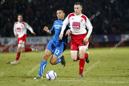 Football - FA Cup Third Round - Stevenage vs Newcastle United Newcastle's Danny Simpson and Peter Winn of Stevenage in action at The Lamex Stadium