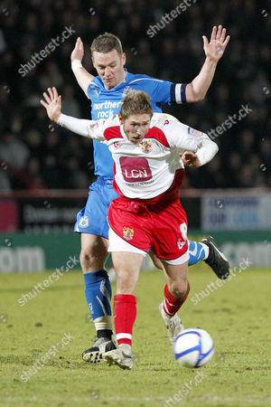 Football - FA Cup Third Round - Stevenage vs Newcastle United Stacy Long of Stevenage and Newcastle's Kevin Nolan in action at The Lamex Stadium