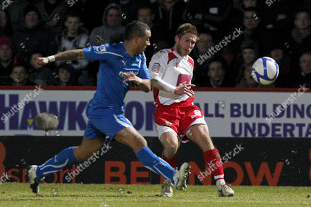 Football - FA Cup Third Round - Stevenage vs Newcastle United Stacy Long of Stevenage crosses the ball under pressure from Newcastle's Danny Simpson at The Lamex Stadium