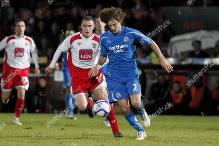 Football - FA Cup Third Round - Stevenage vs Newcastle United Newcastle's Fabricio Coloccini and Peter Winn of Stevenage chase the ball at The Lamex Stadium