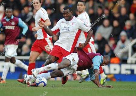 Football - FA Cup Fourth Round - West Ham United vs Nottingham Forest 30/01/2011 Wes Morgan (Forest) Luis Boa Morte (WHU)