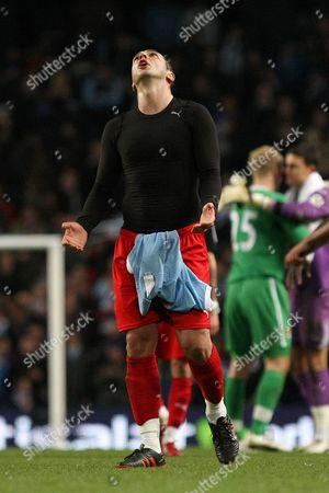 Football - FA Cup Sixth Round - Manchester City vs Reading Zurab Khizanishvili of Reading looks dejected following defeat at the City of Manchester Stadium