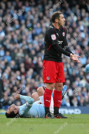 Football - FA Cup Sixth Round - Manchester City vs Reading Zurab Khizanishvili of Reading protests his innocense as Carlos Tevez of Manchester City lies in pain at the City of Manchester Stadium