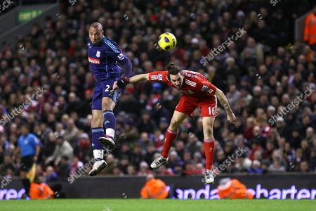 Football - Premier League - Liverpool vs Stoke City Stoke's John Carew and Sotirios Kyrgiakos of Liverpool in action at Anfield
