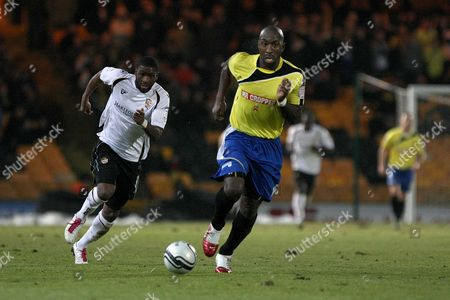 Football - League Two - Port Vale vs Burton Albion Port Vale's Justin Richards and Burton Albion's Darren Moore chase down a loose ball at Vale Park