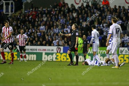 Stock Image of Football - The Championship - Reading vs Southampton Southampton's Dean Hammond starts walking towards the dressing room as Referee Mr J Moss gives him his second yellow card and send him off at the Madejski Stadium Reading