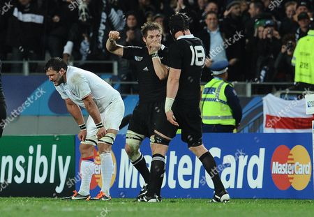 New Zealand v France ; Auckland ; Rugby World Cup Final Eden Park Stadium Final whistle celebrations : Richie McCaw New Zealand captain celebrates as Lionel Nallet shows his despair