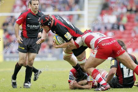 Rugby Union - AVIVA Premiership Play-Off - Saracens vs Gloucester Gloucester's Paul Doran-Jones tackles Hugh Vyvyan of Saracens at Vicarage Road
