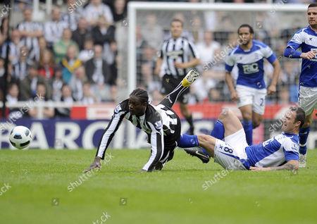 Football - Premier League - Newcastle United vs Birmingham City Martin Jiranek (Birmingham City) brings down Nile Ranger (Newcastle United) at St James' Park