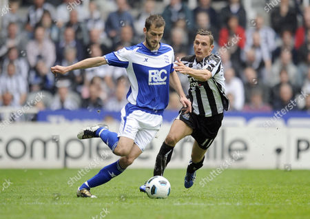 Football - Premier League - Newcastle United vs Birmingham City Roger Johnson (Birmingham City) and Peter Lovenkrands (Newcastle United) at St James' Park