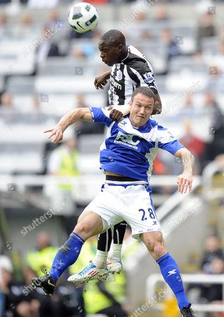 Stock Photo of Football - Premier League - Newcastle United vs Birmingham City Shola Ameobi (Newcastle United) and Martin Jiranek (Birmingham City) go for the ball at St James' Park