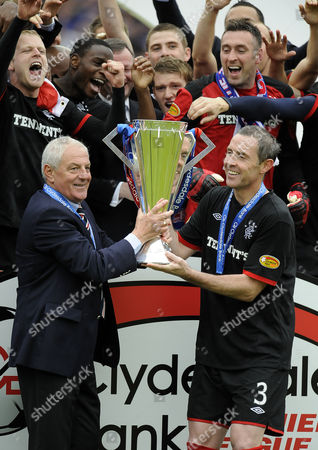 Football - Scottish Premier League - Kilmarnock vs Rangers Rangers' Manager Walter Smith and Rangers Captain David Weir celebrate with the SPL trophy at Rugby Park