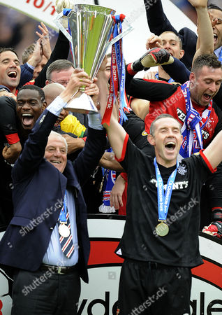 Football - Scottish Premier League - Kilmarnock vs Rangers Walter Smith (Rangers manager) lifts the trophy at Rugby Park