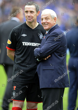 Football - Scottish Premier League - Kilmarnock vs Rangers Walter Smith (Rangers manager) and his captain David Weir (Rangers) take a moment before lifting the trophy at Rugby Park