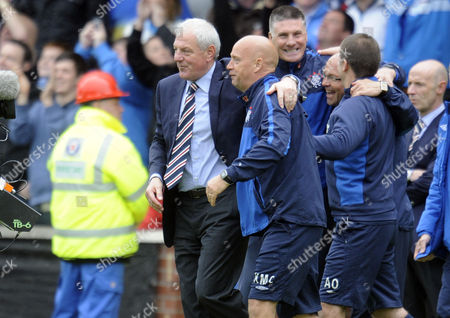 Football - Scottish Premier League - Kilmarnock vs Rangers Walter Smith (Rangers manager) leads the back-room staff onto the pitch at Rugby Park